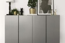 25 two IKEA Ivar cabinets done in grey with paneling and placed on tall legs look very chic and elegant
