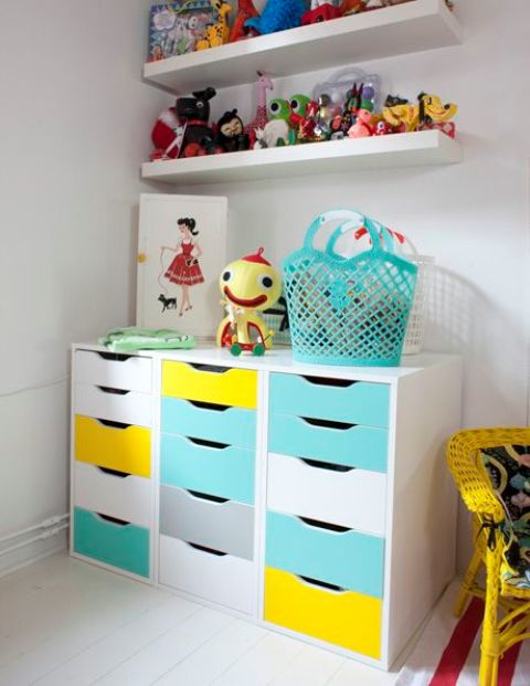 a bold storage unit for a kids' space made of three Alex drawer pieces renovated with turquoise and yellow contact paper