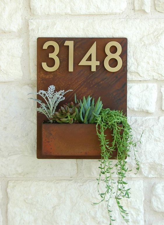 a wall mount house number combined with a succulent planter