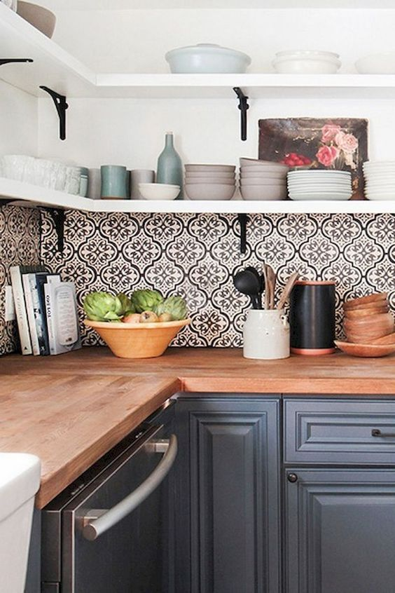 bold mosaic patterned tile backsplash brings interest to this simple grey kitchen