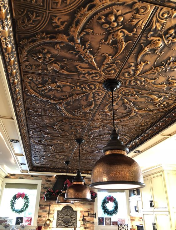 a pressed tin metal ceiling shows off a beautiful vintage pattern that adds an exquisite touch to the space
