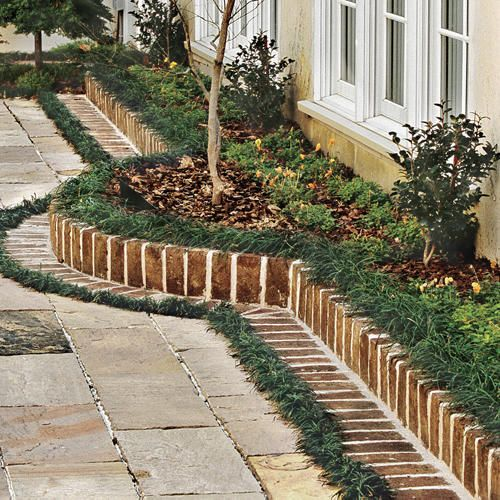 a brick border is a timeless idea to use in any garden, though it's a bit formal, it's cool