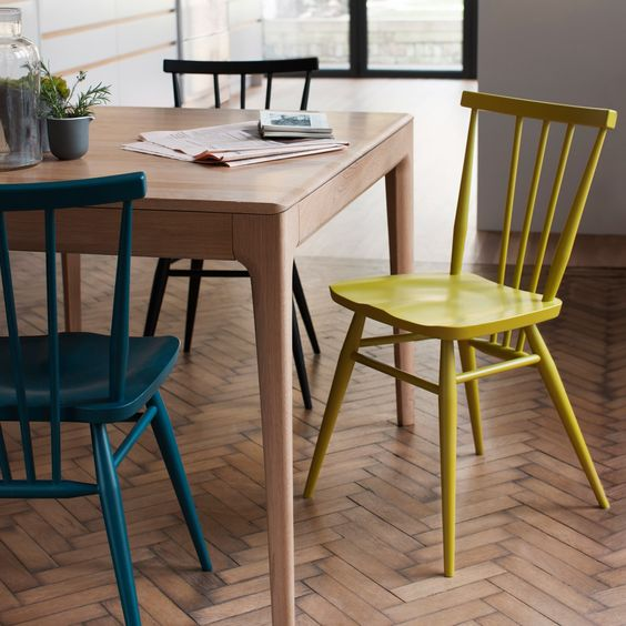 make your simple chairs catchy using different paints to create a bold dining space