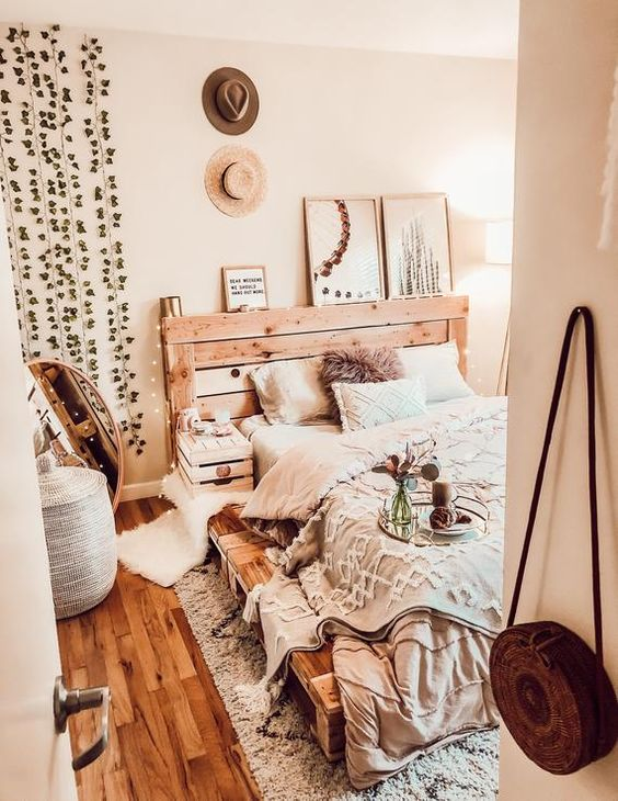 a bed built of pallet wood is a cool and creative idea to give it a less industrial look