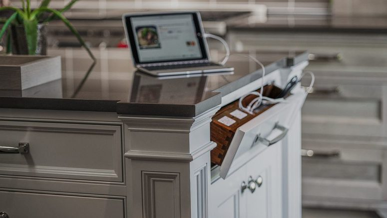 a drawer in your kitchen island is a tiny charging station that can be hidden anytime you don't need it