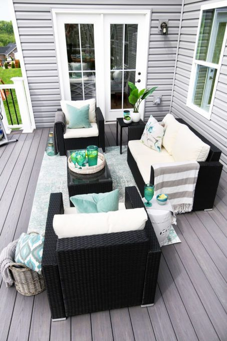 a neutral summer deck done with aqua green accents looks very bright and welcoming