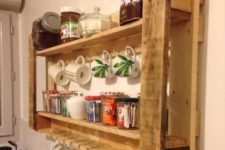 03 a recycled pallet rack for a kitchen features glass and mug storage and jars with various stuff