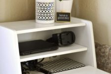 04 a charging station in a vintage breadbox is a fun and catchy idea for a kitchen, no one will guess