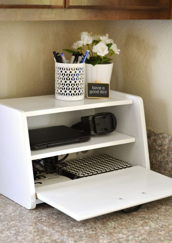 a charging station in a vintage breadbox is a fun and catchy idea for a kitchen, no one will guess