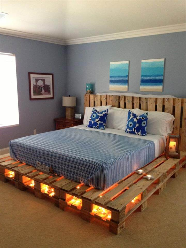a comfy pallet bed with lights inside allows you to skip lamps on your nightstands and creates a romantic ambience