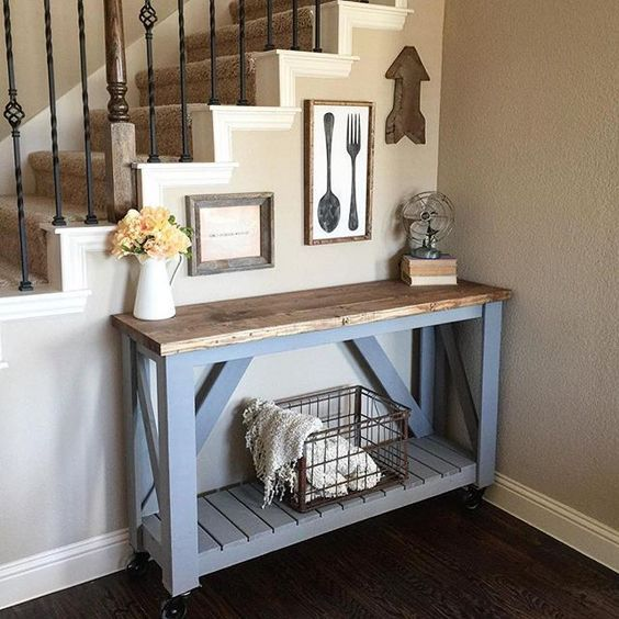 a slate grey pallet console table with a stained tabletop and casters is a timeless option for a rustic space