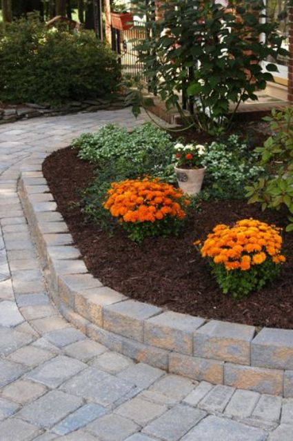 elegant outdoor bricks covering the pathway and the flower bed for a cohesive and more formal look