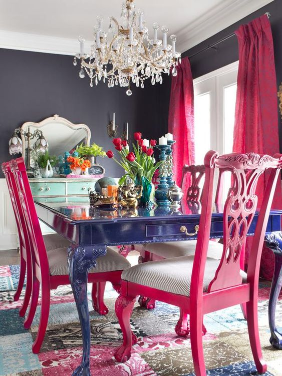 hot pink chairs with striped seats and hot pink curtains spruce up the moody space