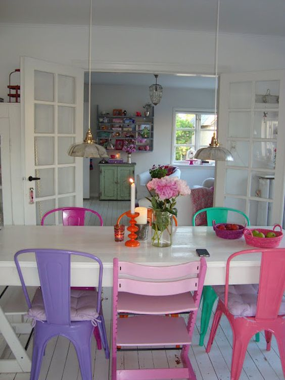 colorful metal chairs - the same chairs and different shades for an eclectic and colorful dining room
