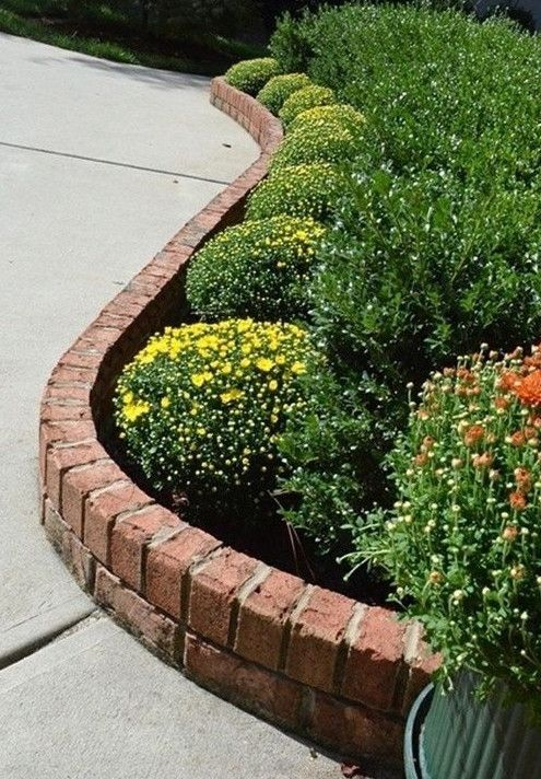red brick garden bed edging is a stylish idea with a very neat final look, it always works