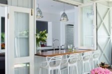 06 a foldable window with a stained tabletop and cool white stools for an outdoor bar or breakfast space