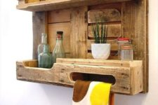 06 a rustic pallet kitchen shelf with a lantern, jars and bottles and even a towel holder is a cool piece