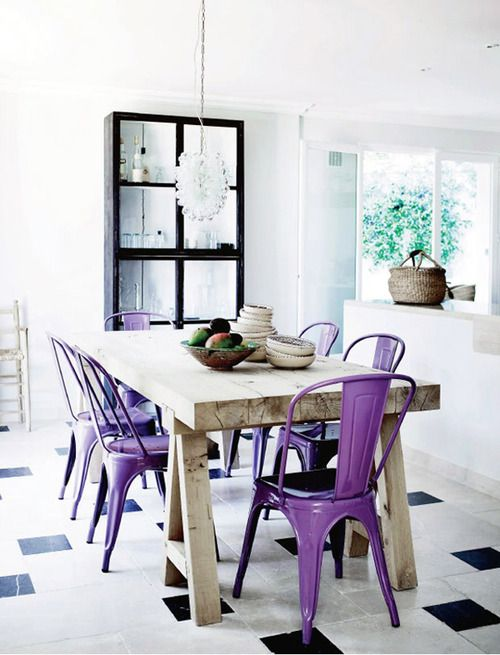 classic metal chairs painted purple add color to the space and spruce the neutral kitchen up