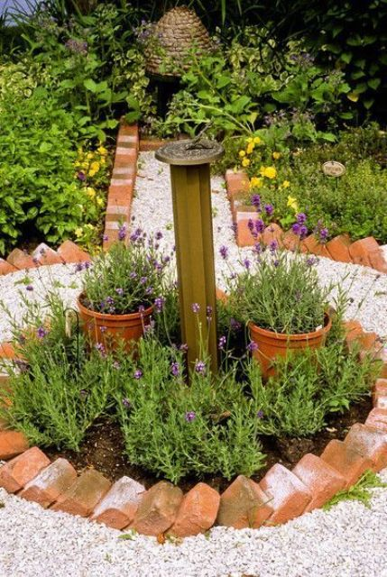 usual red bricks are a very cool idea for a garden bed and contrast with bright and neutral blooms and neutral gravel
