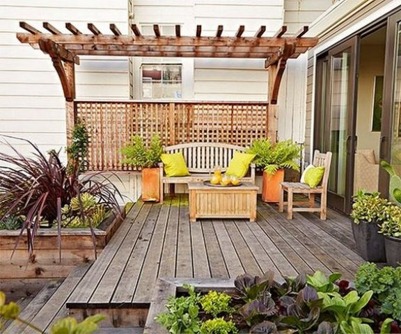 a bright summer deck decorated with orange and neon green touches for a bright ambience