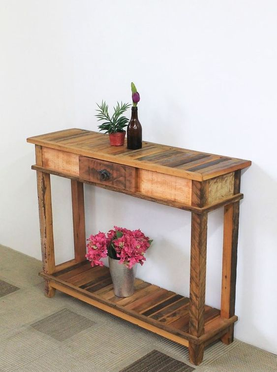 a rustic pallet console with a slatted top and shelf plus a small drawer for a small entryway