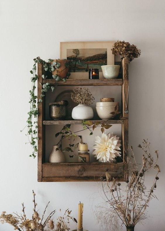 a rustic pallet shelf built of pallet wood and stained in a rich tone is a stylish storage furniture piece for many spaces