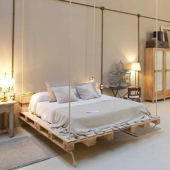 a hanging pallet bed is a creative and chic idea, it's very dreamy and less bulky-looking
