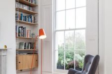 08 a retro-inspired grey wingback chair with a matching footrest and touches of orange plus a bold orange lamp