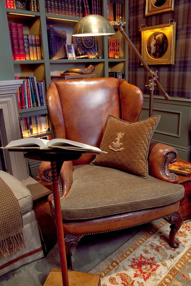 a large vintage leather and fabric chair is very refined, a metal floor lamp and a book stand for more comfort