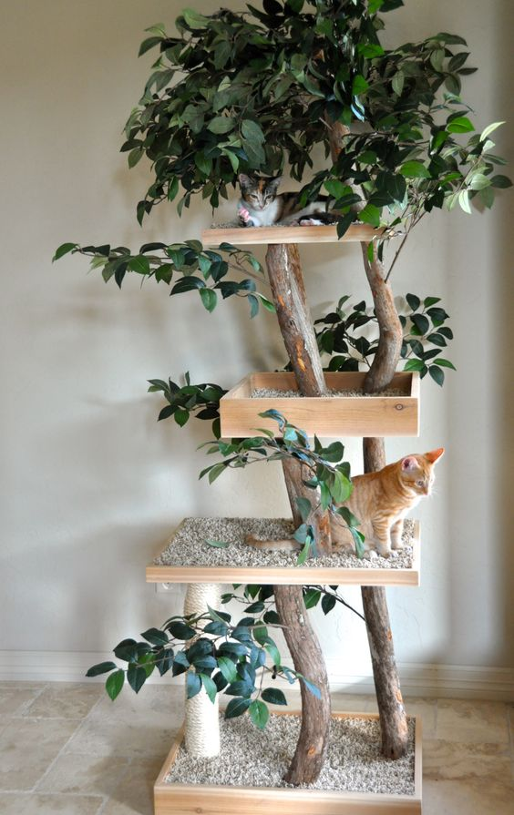 a nature-inspired cat tree of branches, fake greenery and platforms with pebbles to make the cats feel like outdoors