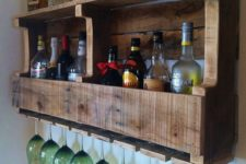 09 a rustic pallet wine rack with wine bottles and liquors and storage for glasses is a cool and simple DIY