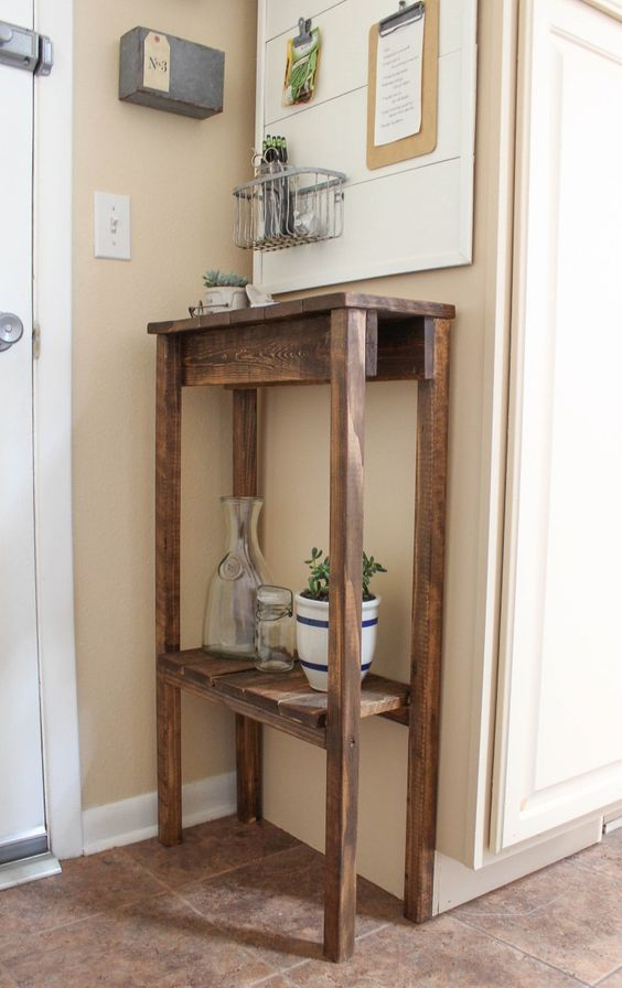 a rustic tall stained pallet console with an additional shelf for storage is a perfect idea for your tiny entryway