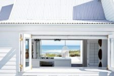 09 a simple white frame foldable window and a white wooden tabletop and stools for a beach home