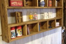 10 a rustic shelving unit with many compartments built of stained pallet wood is a cool DIY
