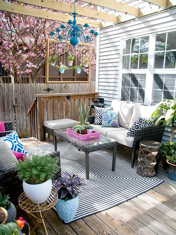 a super bright deck with touches of bold blue, hot pink and fresh greenery plus geometric prints