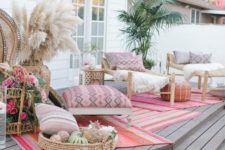 11 a Moroccan style deck with pink and fuchsia touches and neutral is very chic and inviting