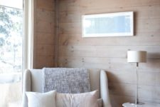 11 a comfy oversized neutral chair with cushions and pillows placed by the window to read cozily