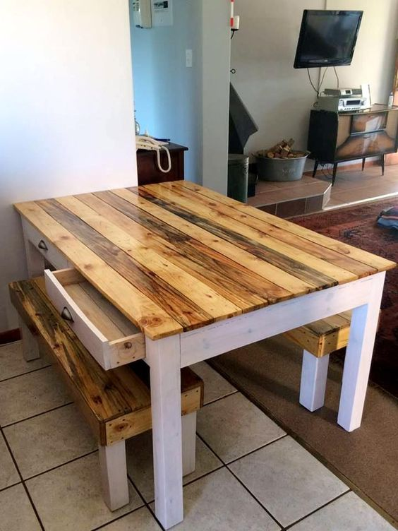 a simple rustic dining furniture set of a table with a light-colored tabletop and benches that match