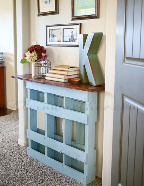 a vintage-inspired blue console table of a pallet with a rich-colored wooden tabletop is ideal for a sleek space