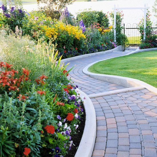 brick pathways and minimalist concrete edging are a nice backdrop for super bright flowers