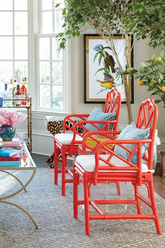 super bold red chairs with white cushions and blue pillows will immediately spruce up the space