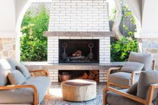12 a bright outdoor lounge with a fireplace, a mosaic tile floor and a bold table plus comfy chairs
