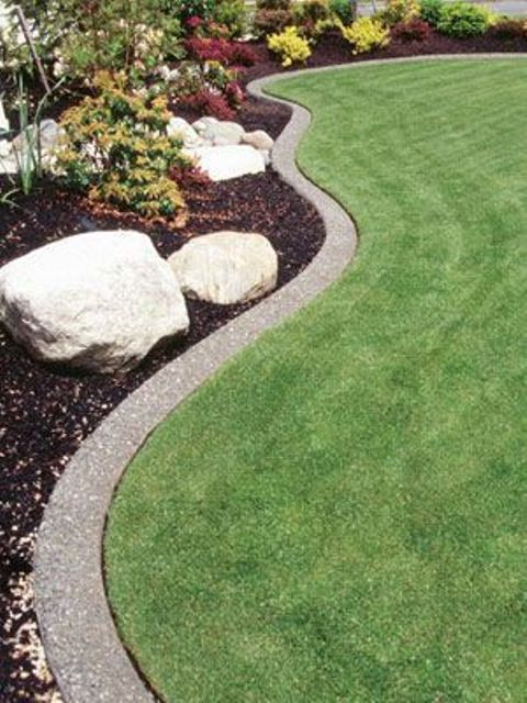 a minimalist lawn, gardne bed and curved concrete gardne bed edging that perfectly matches the landscape