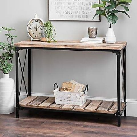 an industrial console table with metal legs and frames and pallet wood will easily fit a farmhouse entryway