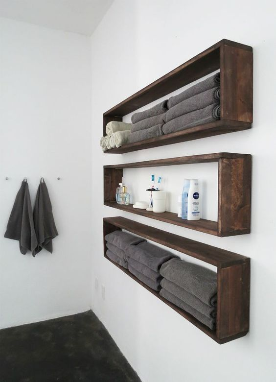 sleek and long wall mounted bathroom shelves buuiltof dark sained pallet wood are ideal if you have little space