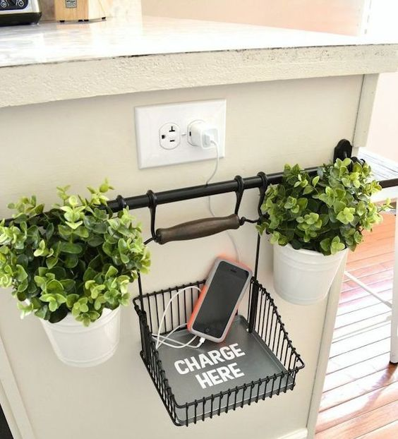 a holder under the sockets and a charging wire basket and potted greenery for a cool and chic look