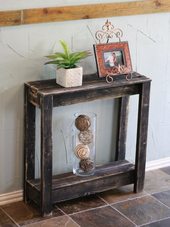 a shabby chic dark stained small console table will be a fit for a farmhouse or vintage entryway