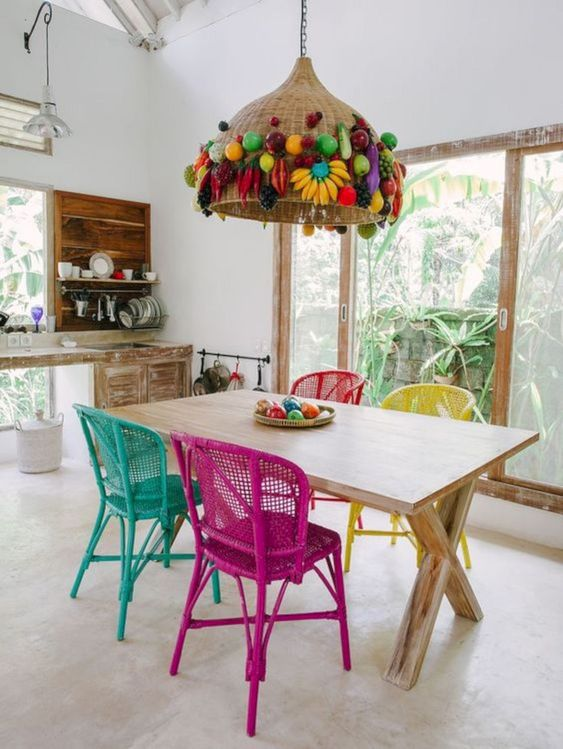 painted wicker chairs and a wicker lampshade decorated with faux fruit for a tropical dining space