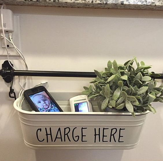a holder with a hanging metal tub for charging and potted greenery can be DIYed very fast