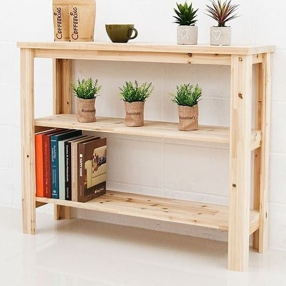 a narrow console table built of pallet wood and stained in a light shade to make it look fresher